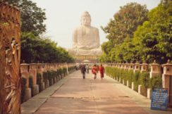 BODHGAYA, INDIA - JANUARY 8: Monks and other people rushing to 24.38 metre Buddha statue on January 8, 2013. Bodhgaya is a place of pilgrimage. Siddhartha Gautama attained enlightenment here at 500 BC